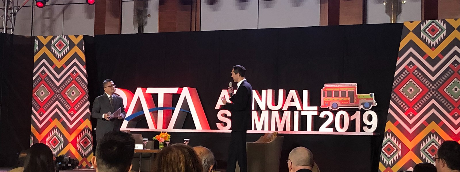 Picture of a person giving a talk on stage at the PATA Annual Summit.