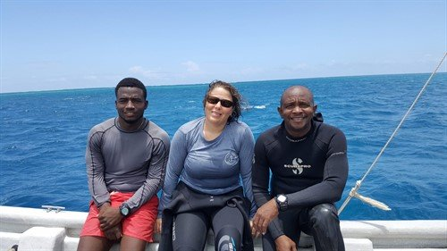 Picture of three members of the Green Fins Antigua & Barbuda team on a boat.