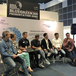 Picture of a panel of speakers on stage in the BlueGreen360 Presentation Zone at ADEX Singapore.