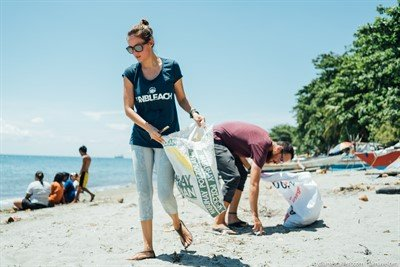 Picture of volunteers collecting trash during a beach clean-up event.