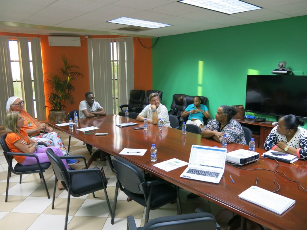 Picture of people sitting around a table at the meeting between Reef-World and the Department of Fisheries in Antigua & Barbuda.