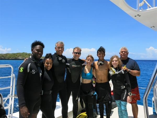 Picture of a group of Youth Ambassadors on a boat in the Dominican Republic.