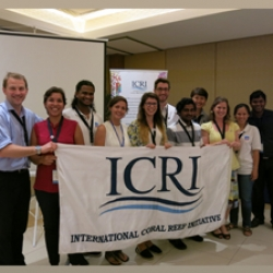 Picture of Reef-World staff with Green Fins national teams at the ITMEMS5. They are holding an ICRI banner.