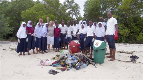 Picture of Furaha's beach cleaning team with the they trash collected.