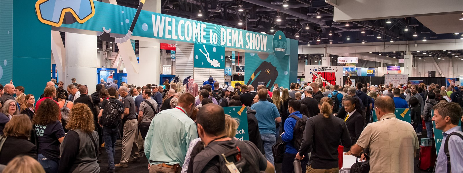 Picture of a crowd of people entering the DEMA show in Las Vegas.