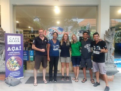 Picture of the Green Fins team with some of the new assessors outside a dive centre.