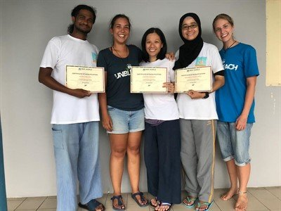 Photo of Samantha Craven and Melissa Hobson (Reef-World) presenting Alvin, Sue and Ira (Reef Check Malaysia) with their certificates to certify them as qualified assessor trainers
