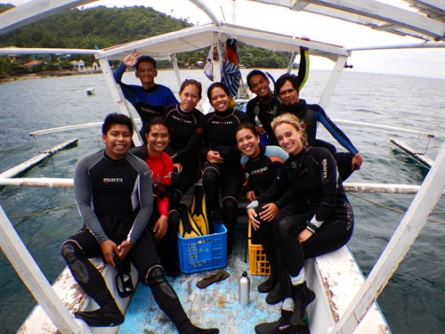 Picture of the Reef-World and Green Fins Philippines teams on a diving boat.