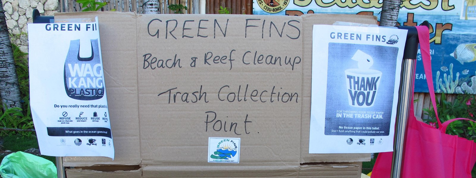 Picture of a sign for the trash collection point during the Green Fins clean-up event.