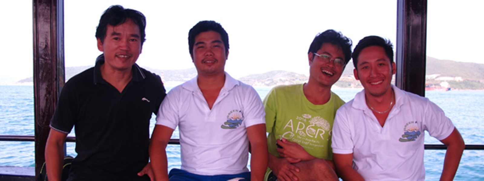 Picture of members of the Green Fins Vietnam team on a boat.
