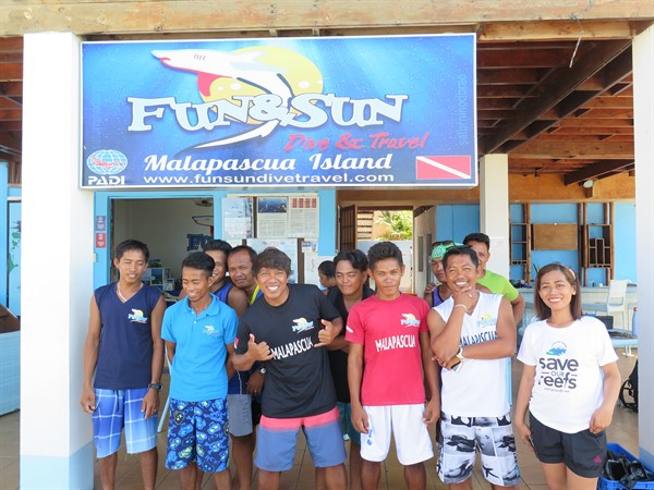 Picture of Green Fins members in Malapascua outside a dive shop.