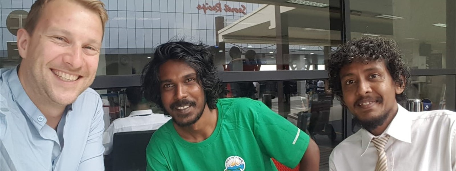 Picture of Reef-World Director JJ Harvey with members of Green Fins Maldives.