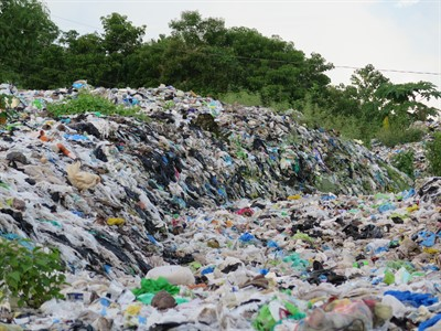 Picture of a landscape covered in hundreds of single-use plastic items.