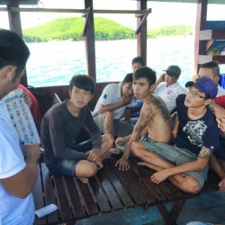Picture of the Green Fins Vietnam team meeting with dive centre staff.