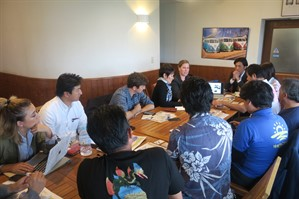 Picture of the meeting between Mel and Chloe from Reef-World with the team from Onna Village.