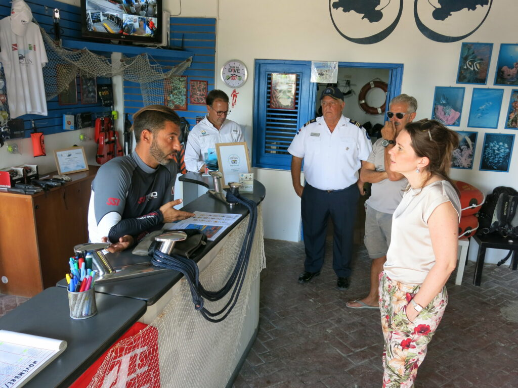 Picture of Reef-World team talking with dive shop team in Dominican Republic.