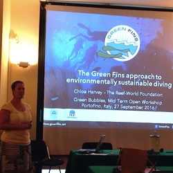 Picture of Chloe from Reef-World giving a presentation about the Green FIns approach to environmentally sustainable diving.
