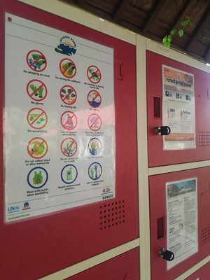 Photo of Green Fins posters on display on lockers at a dive centre.