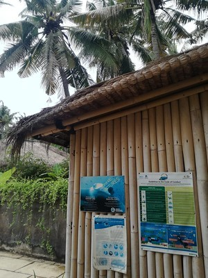Picture of Green Fins posters and guidelines outside a dive centre.