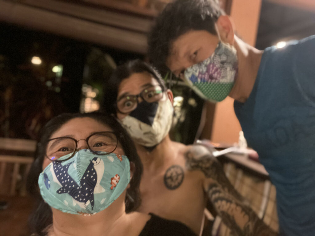 Photo of the Bubbles Dive Centre team wearing reusable fabric face masks. They are one of three winners of the Green Fins 2020 award.