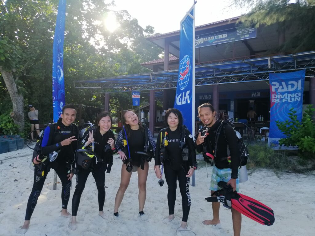 Group of divers who have just completed their Open Water with Flora Bay Divers