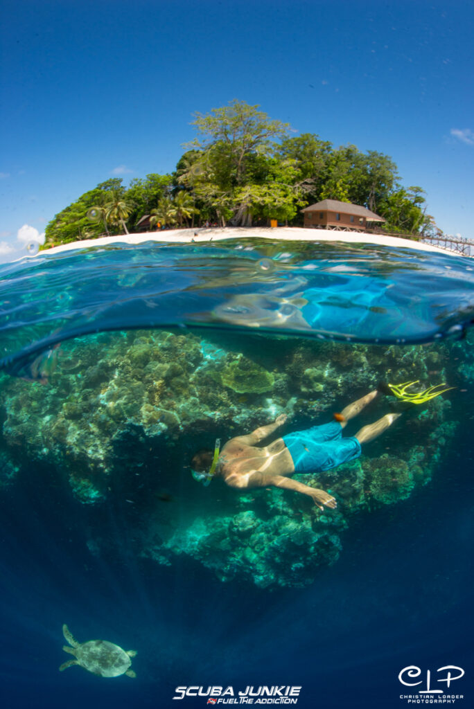 A snorkeller enjoying the underwater world at Pulau Sipadan with Scuba Junkie (Photo credit: Christian Loader)